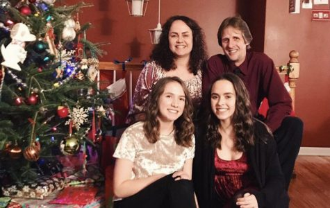 Senior Hannah Turner and her family spending time by the Christmas tree this holiday season.