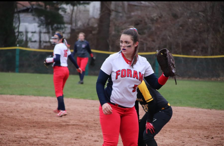 Junior softball player Marguerite Collette mid play at the Law game last year. Photo cortesy: Corina Massey