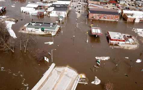 Photo Courtesy: Dave Kettering, USA Today Towns in the Midwest flooded underwater with catastrophic damage.