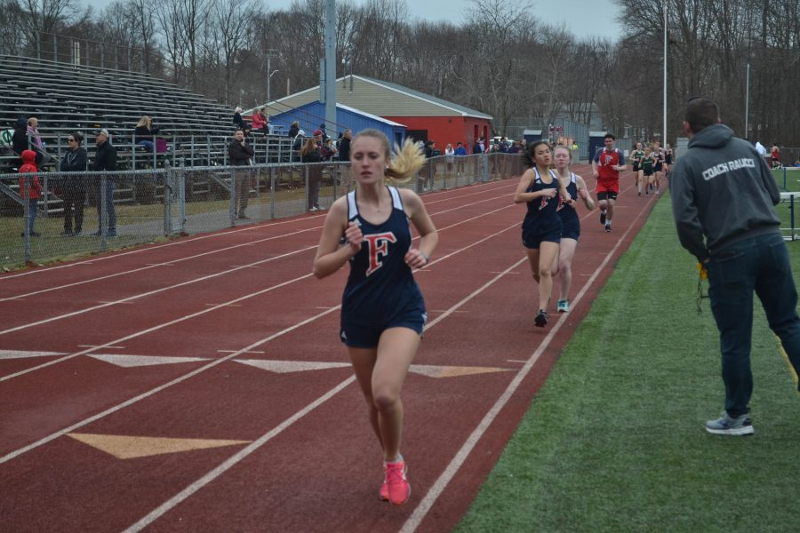 Emma Cote runs during an April home meet. Photo courtesy Jesse Figueiredo