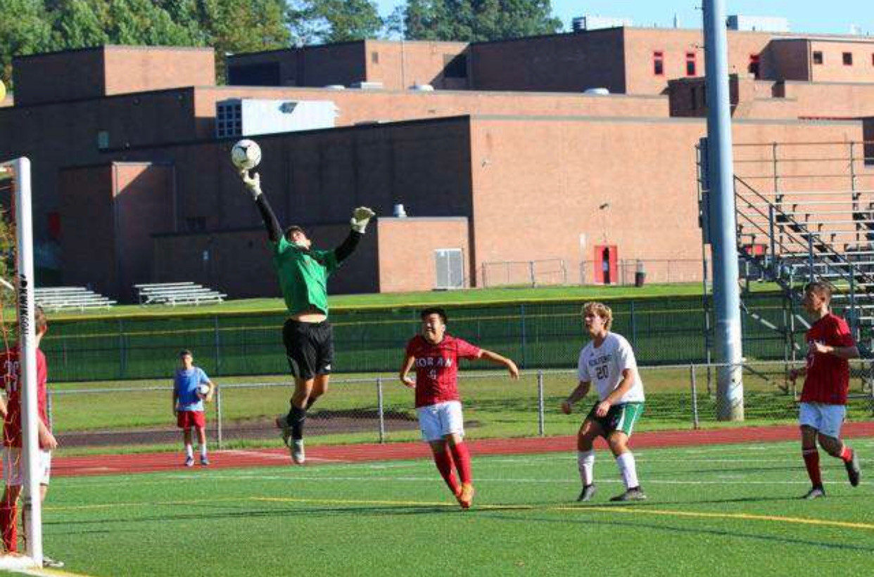 Goalkeeper, Luca Marinelli jumps up to block a ball in a home game last year. Photo Courtesy of CamPhotography.