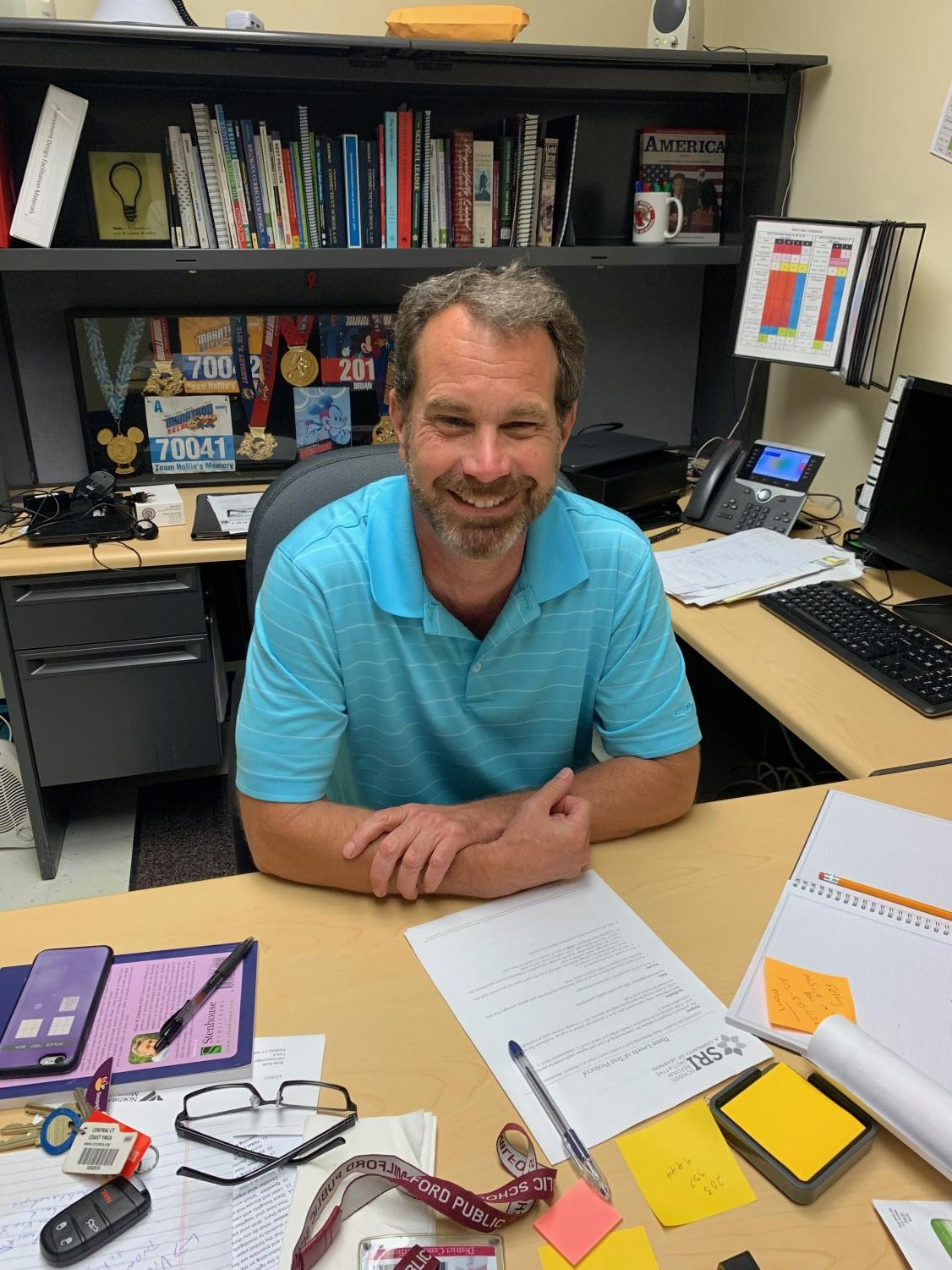 Mr. Brian Scott in his new office on August 13, 2019, excited to start the new school year. Photo taken by Carly Whelan.
