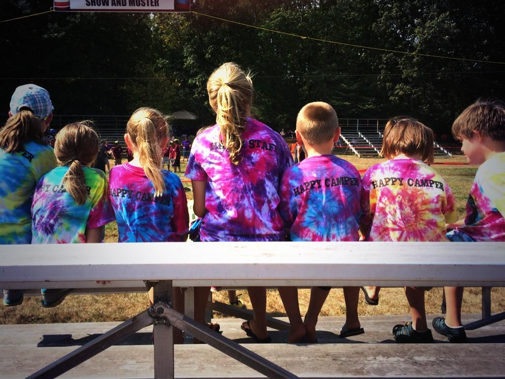 A sunny day at the Fire Muster as Camp Happiness kids watch. Photo courtesy of Camp Happiness Twitter.