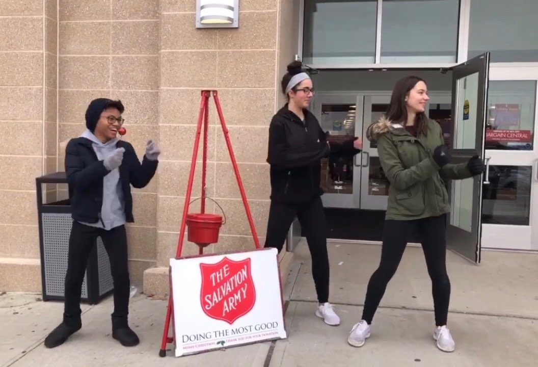 Foran students volunteering to raise money for the Salvation Army.
