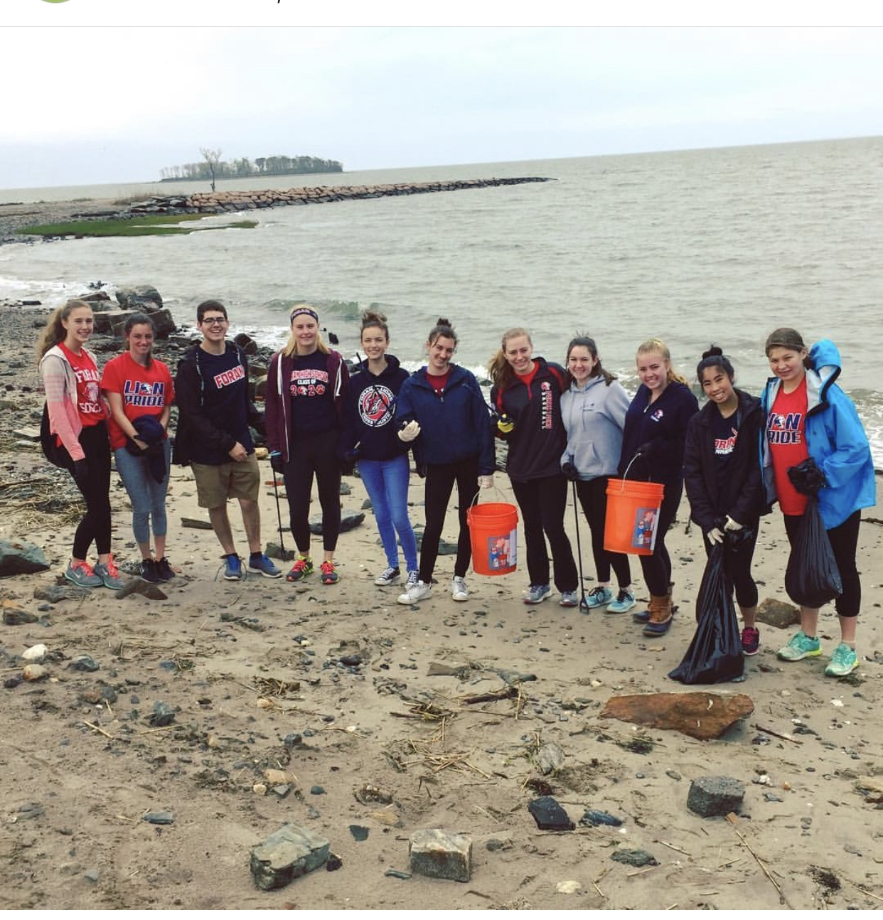 Foran's Environmental club participating in a beach clean up. Photo courtesy of fhsenviclub on Instagram.