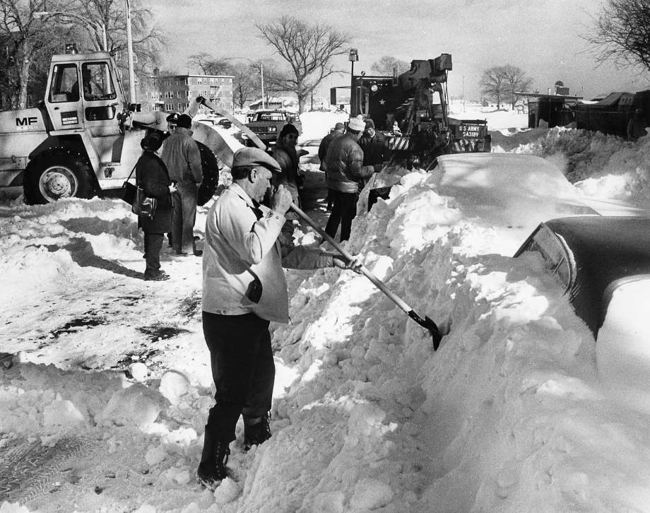 A man in Boston attempts to dig out his car amongst the aftermath of the 1978 blizzard. Photo courtesy of CTPost.