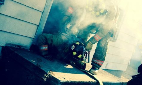Milford firefighters battle on the scene. Photo courtesy of Milford firefighter Facebook.