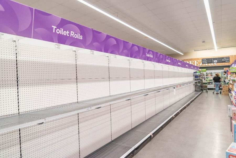Toilet paper shelves empty at a store. Photo courtesy of Getty Images.