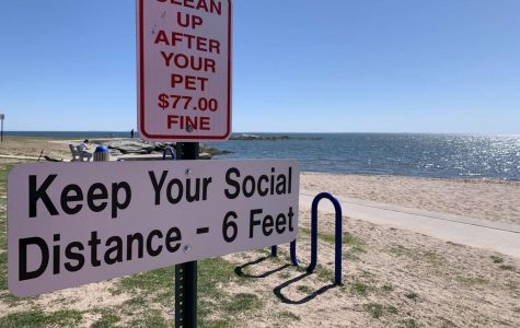 Anchor Beach, located in Milford, has put up signs encouraging social distancing. The sign warns people to keep their distance from others to stop the spread of Covid-19. Photo taken April 6, 2020. Photo courtesy of Kailey Howell.