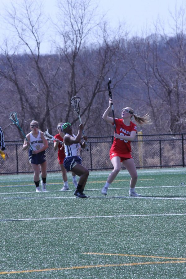 Senior Bridget Collins after the draw in the Notre Dame vs Foran lacrosse game.  	Taken on March 30, 2019, by Christopher DeMott.