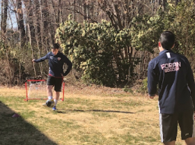 Foran Students Ben and Sam Cogan  playing soccer in their garden due to the pandemic restrictions. Photo courtesy of Kevan Cogan.
