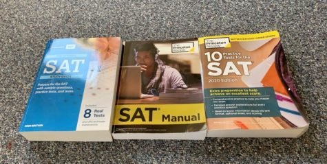 multiple textbooks Junior Shea Carroll has used to prepare for the SAT. Photo courtesy Shea Carroll