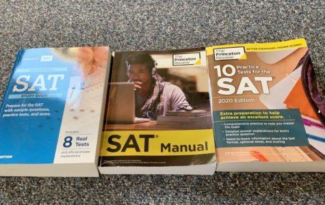 multiple textbooks Junior Shea Carroll has used to prepare for the SAT. Photo courtesy Shea Carroll