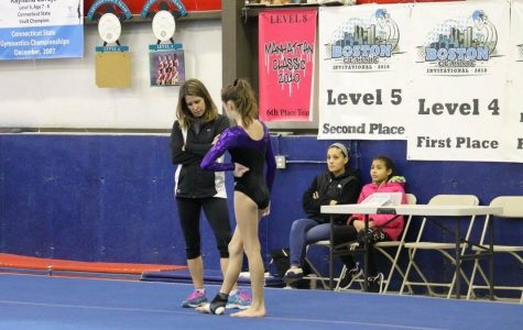 Coach Lisa Dodge of Polly's at a meet with one of her gymnasts.  Photo Courtesy:  Samantha Lambert, January 2016