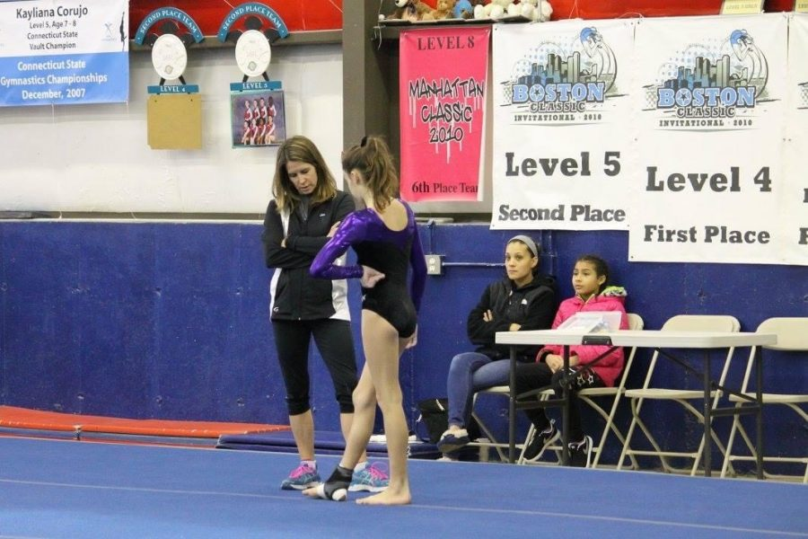 Coach+Lisa+Dodge+of+Polly%E2%80%99s+at+a+meet+with+one+of+her+gymnasts.%0A+Photo+Courtesy%3A++Samantha+Lambert%2C+January+2016
