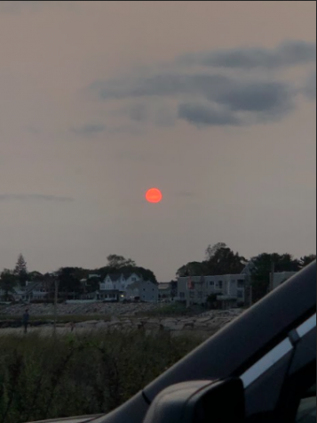 In the past few weeks, air quality all the way on the Eastern seaboard has been affected. In this picture from September 16 in Milford, Connecticut, the sun appears red as it sets because of the California smoke in the air. Photo courtesy of Emma Fiorillo.