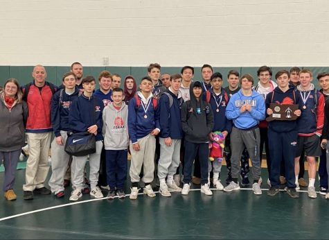 The wrestling team poses after placing second this past year at the Class M state Championship. February 22, 2020, Foran Wrestling Team at Guilford High School being runner up in the Class M State Championship. Photo Courtesy: Coach David Esposito.