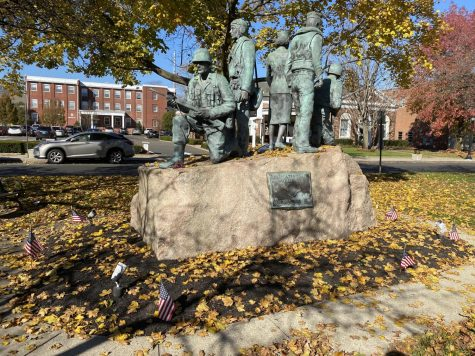 Caption: In Honor of Veterans : Veterans are remembered in Milford. Downtown there is a World War II monument at the Milford Green. Photo courtesy: Daniel Abate, November 9, 2020.