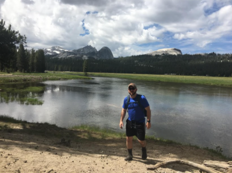 Enjoying the Outdoors: Mr. Phelan poses in front of the mountains at Yosemite Park after a successful hike participating in another one of his many hobbies. Photo Courtesy: Zachary Phelan.