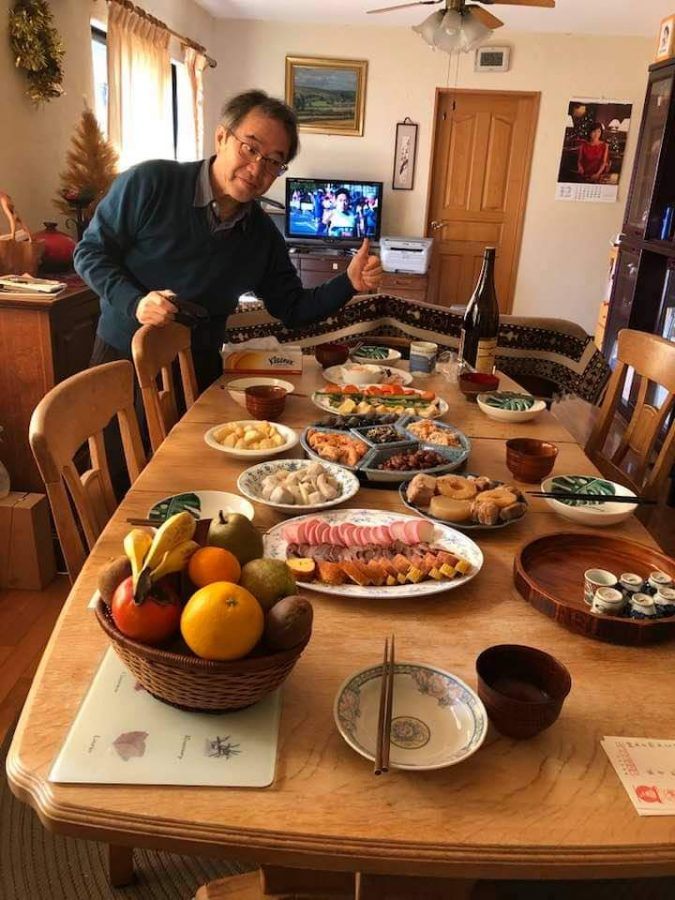 A Meticulous New Year: Mr. Nobuyuki Sakai poses next to the foods they've prepared for their family's New Year's holiday dinner celebration in Japan. Photo courtesy: Noriko Sakai, January 1, 2019.