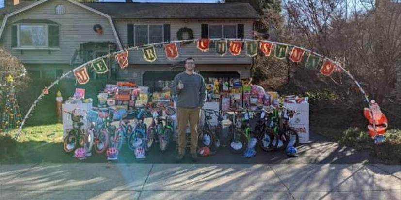 The Most Wonderful Time of the Year: John Krusinski stands in front of the donations he's collected for Toys for Tots this holiday. Photo courtesy Krusinski family.