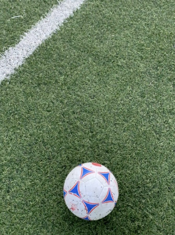 A+soccer+ball+on+an+artificial+turf+soccer+field.+Photo+Courtesy+of+Luca+Marinelli%2C+December+12%2C+2020.