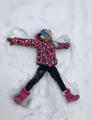 Making the Most of the Snow: Isabella Torres making snow angels. Photo courtesy: Bianca Torres. December 2016.