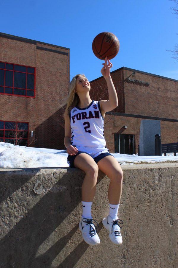 Captain Lauren Heenan showing off her basketball skills.