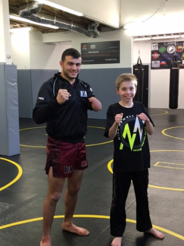 Ready to fight: Nick Newell and James Dalby posing for a picture at Fighting Arts Academy CT. Photo Courtesy: Karen Dalby, 2016