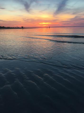 The sun setting on the sand bar on one of Cape Cod's beaches. Photo courtesy of Anna Paul.