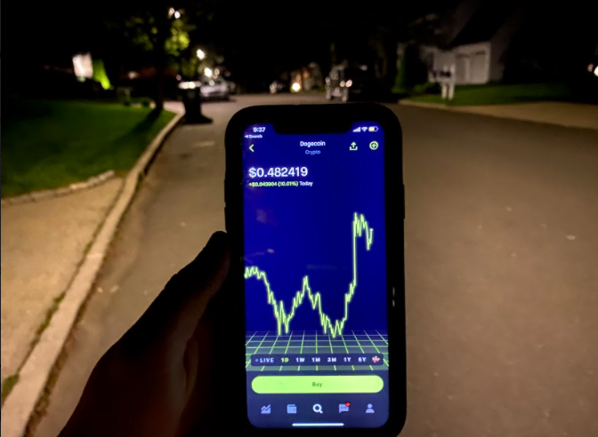 Investing has never been easier than now, and can be done right through the phone while going on a walk. Photo courtesy: Nate Wolfe.