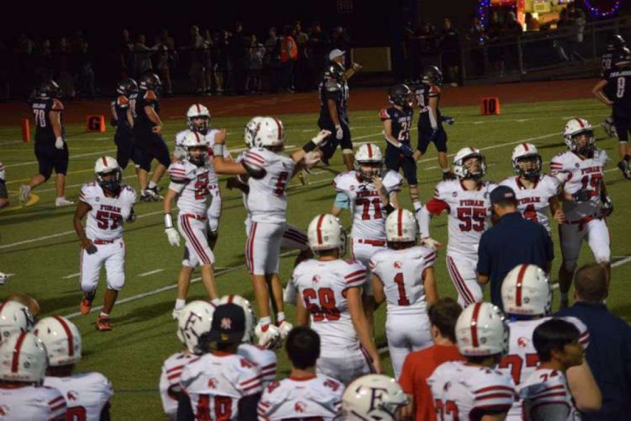 Foran versus Lyman Hall: Football's first game, celebrating their victory. Photo courtesy: Dean Ross, September 10, 2021.