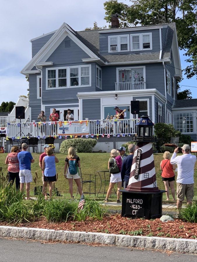 Porchfest in Action: An act in this year's Porchfest plays their music for Milford locals to enjoy. Photo Courtesy: Jacquelyn Wrigley, October 2, 2021.