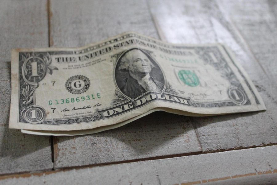 One of 28 Trillion: A one dollar note represents the scope of the National Debt.
