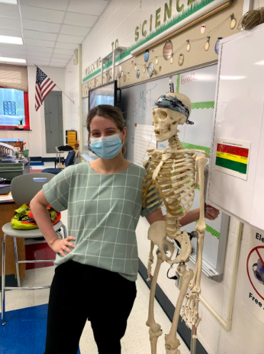 Toon and Bones: Baleigh Toon poses with a model skeleton in her temporary classroom. Photo courtesy: Owen McCabe, September 23, 2021.